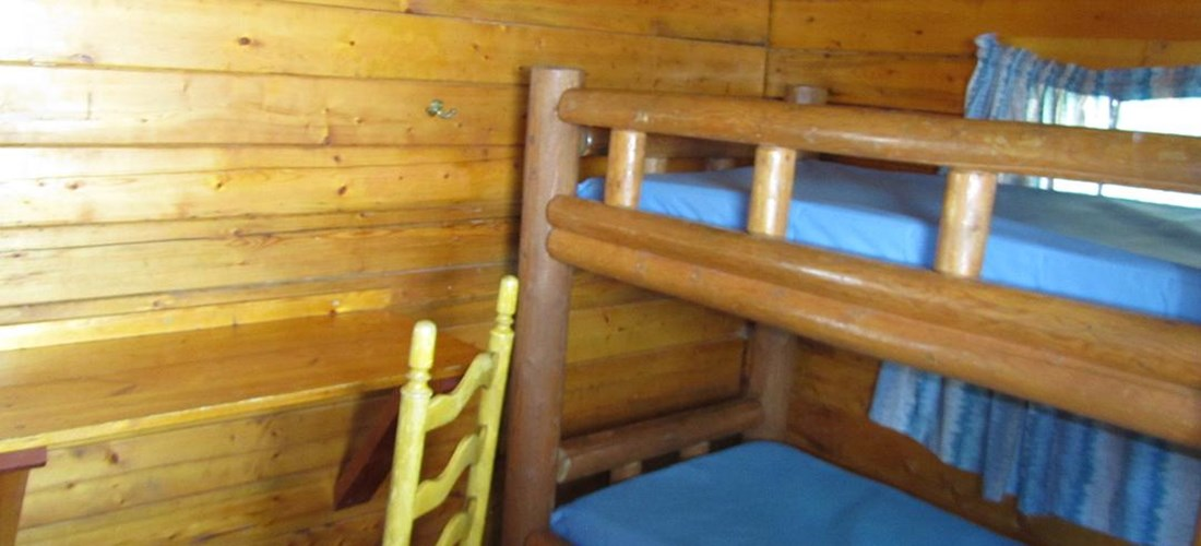 Our 2 room Camping Cabins sleep six comfortably.  Don't forget your sleeping bags!
