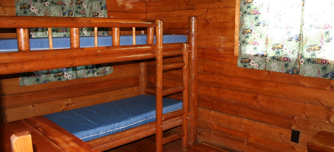 The bunk room has two sets of bunks and allows the cabin to sleep 6.