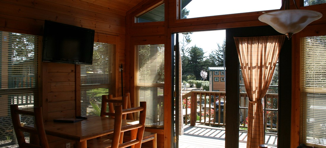 "Enjoy coffee on the deck or catch the game on the 32"" Satellite TV"
