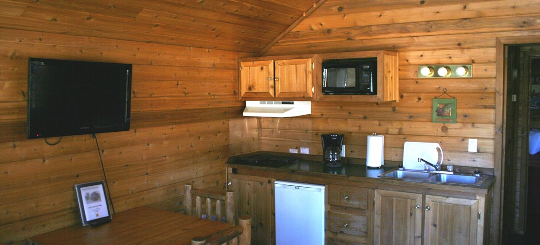 Our Deluxe Cabins even have televisions and the kitchen is well appointed.