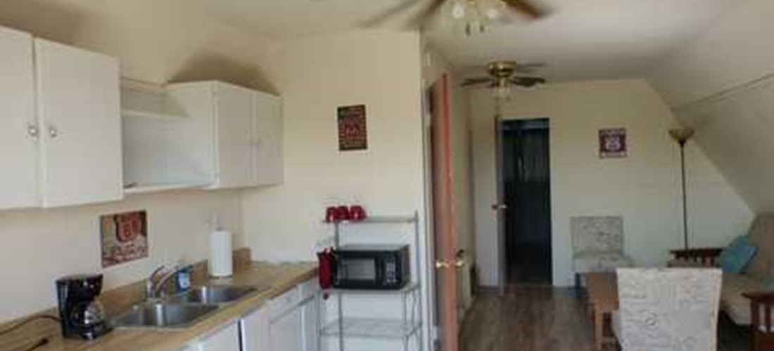 Kitchenette with microwave, refrigerator and coffee maker.