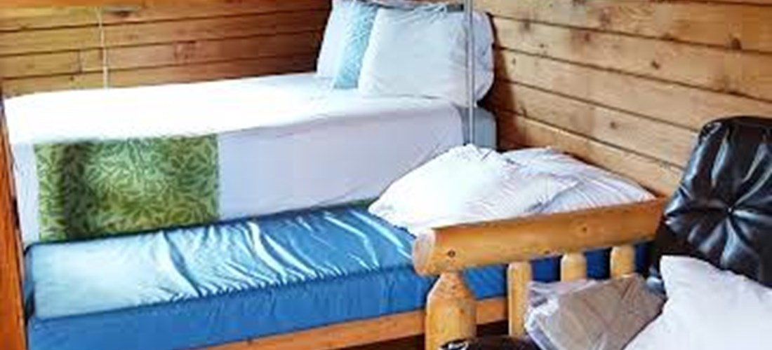 Log double bed and bunkbed downstairs