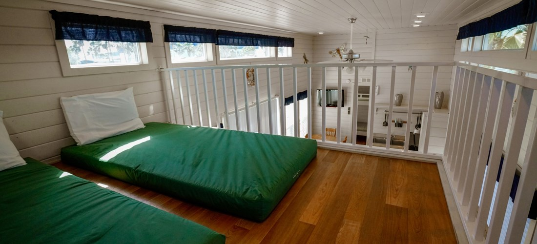 Kids love the upstairs loft in our Loft Cabins