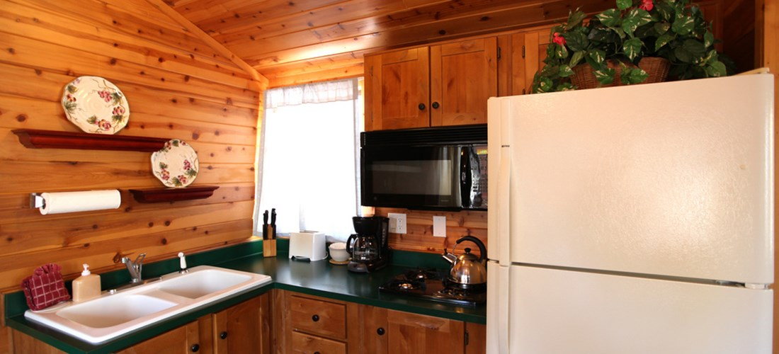 The kitchen is stocked with cooking utensils and dishes for use during your stay.