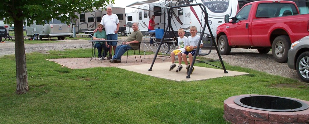 Deluxe Patio Site.  Enjoy one of our most popular  & spacious sites.  Brick Patio, Fire Ring, Patio Swing, and Furniture.