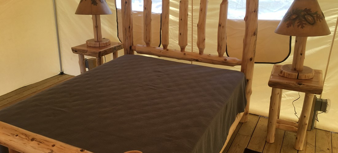 Bed in glamping tent