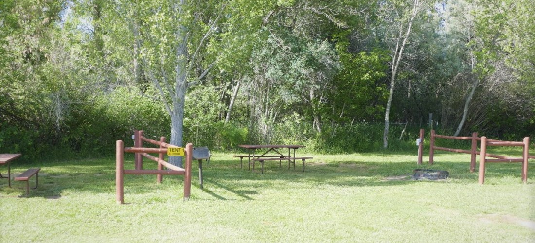Park right along the fence, in front of your tent site for easy unloading of your camping gear.
