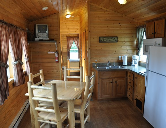Our lodges are ready for you! Complete with pans, dishes, silverware, coffee pot. You bring your bedding and towels!