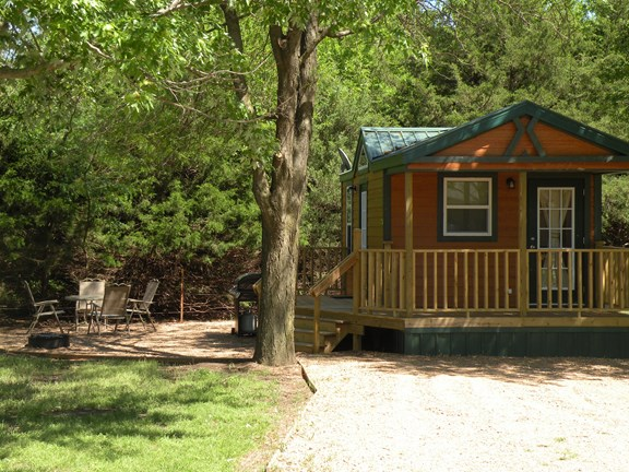 Deluxe cabin with propane grill and fire pit.