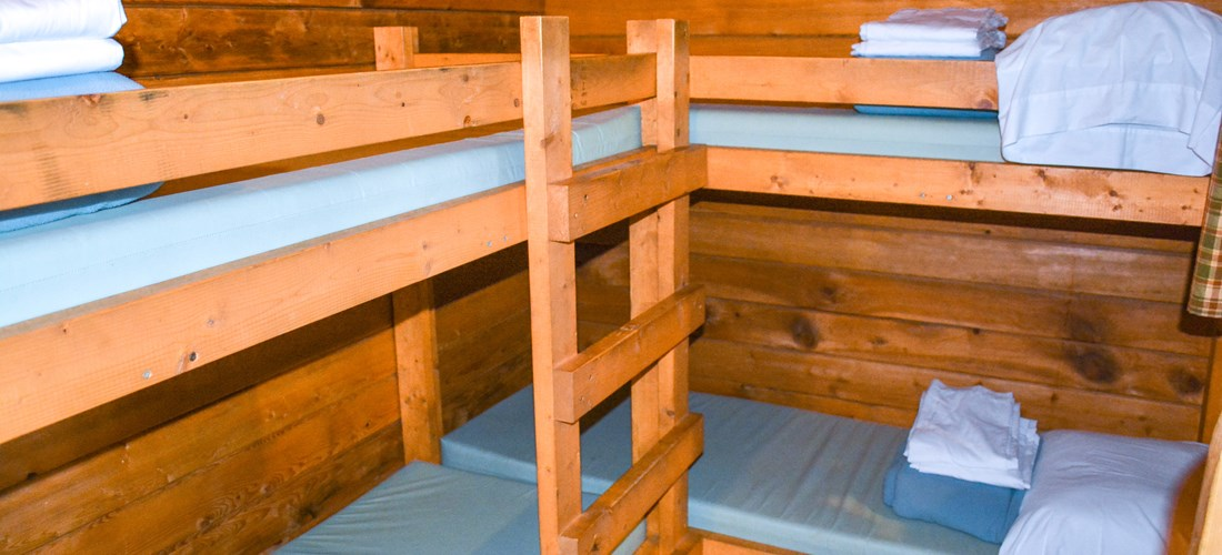 The bedroom comes with 2 single bunks and linens are included.