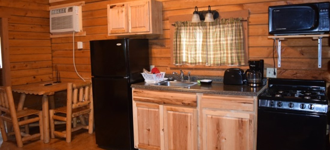 The kitchen area of our Country Cottage is spacious and comes with a full fridge, stove, toaster, microwave, and all of your kitchenware.
