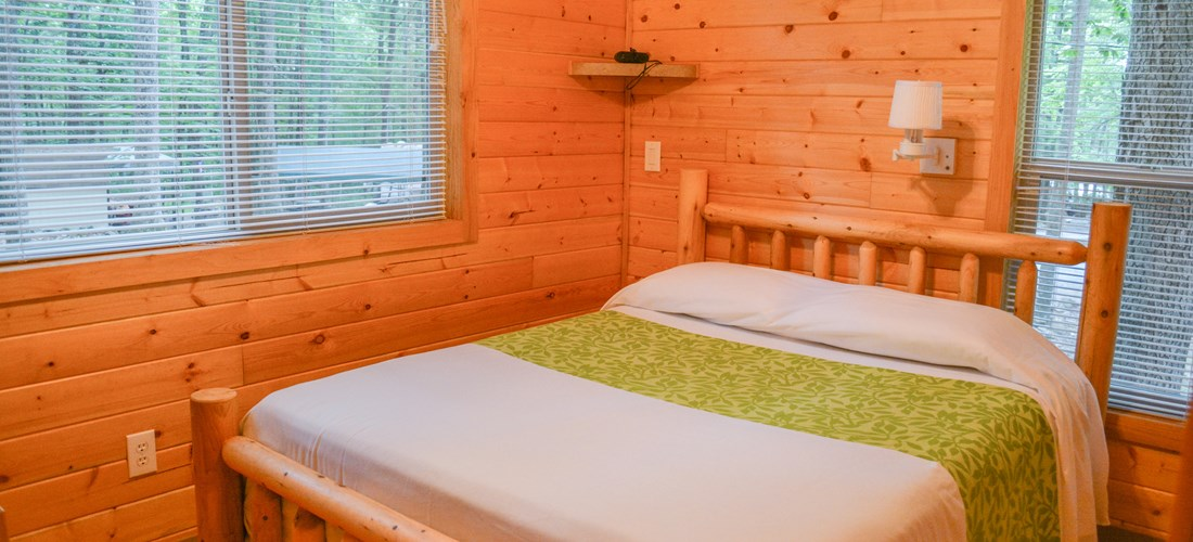 The bedroom includes a queen bed and linens are provided.