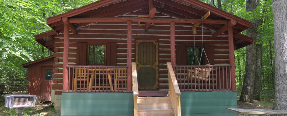 The Large Log Cabin Home is in a secluded wooded area for you and your family to enjoy.
