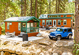 Two cabins and a Jeep