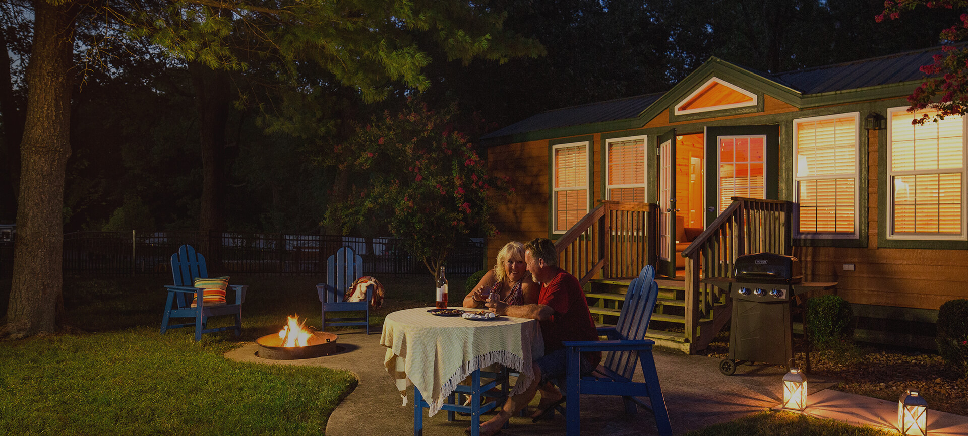 Camping cabin at night with outside dining