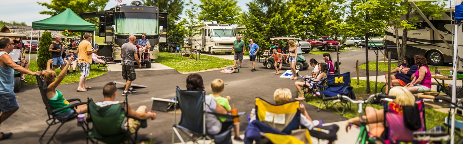 Group Camping RV Sites - Roll Up in Your Rigs and into our RV campsites for Groups. We have 30 and 50 amp service with full hookups on pullthru and back-in sites